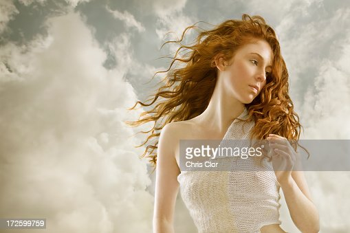 Caucasian woman's hair blowing in wind : Stock Photo