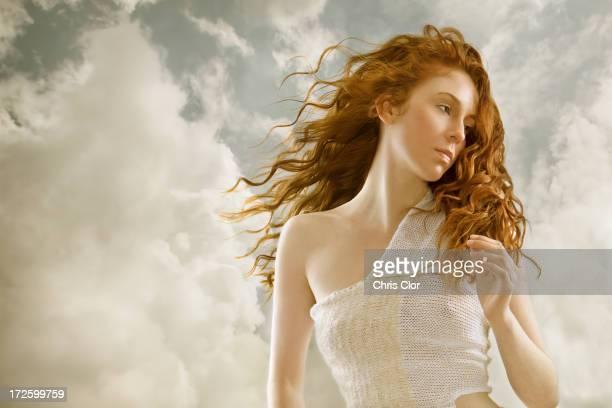 Caucasian woman's hair blowing in wind