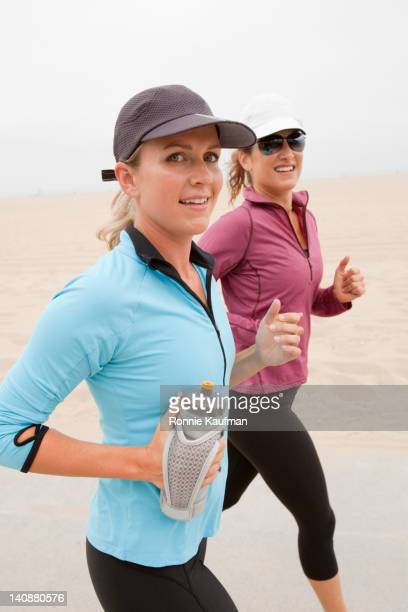 Caucasian women running together