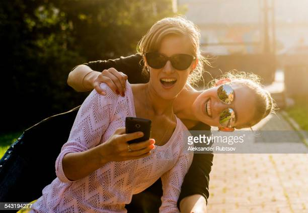Caucasian women taking cell phone selfie