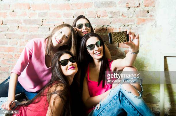 Caucasian women taking cell phone selfie