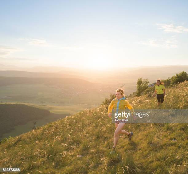 Caucasian women trail running outdoor on green meadow