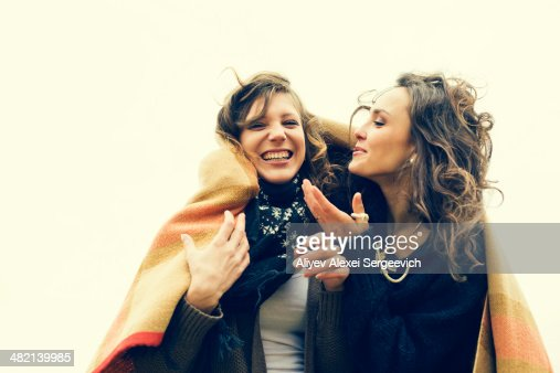 Caucasian women wrapped in a blanket