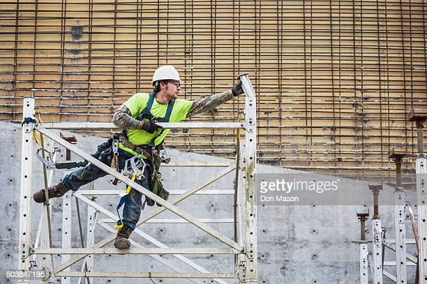 Caucasian worker on scaffolding