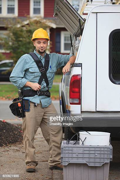 Caucasian worker smiling at truck