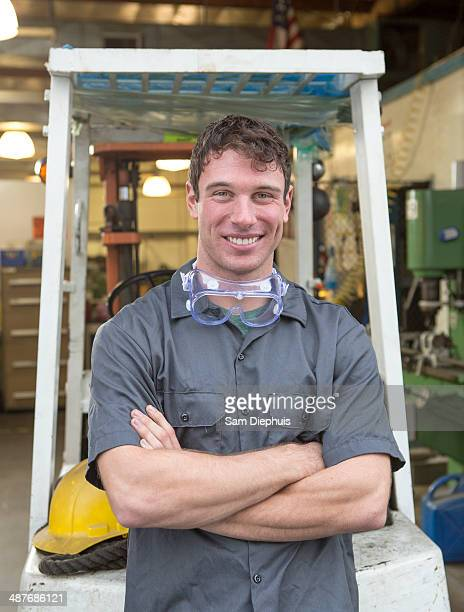 Caucasian worker smiling in warehouse