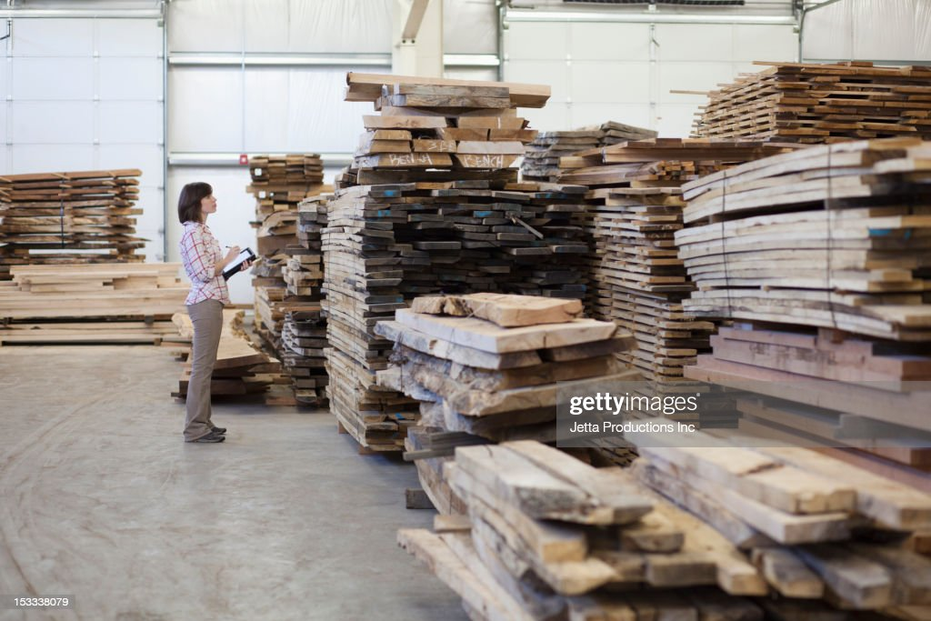 Caucasian worker with lumber in warehouse