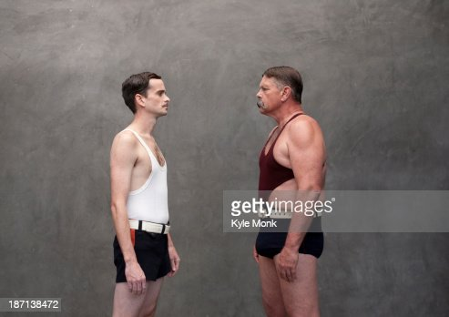 Caucasian wrestlers examining each other