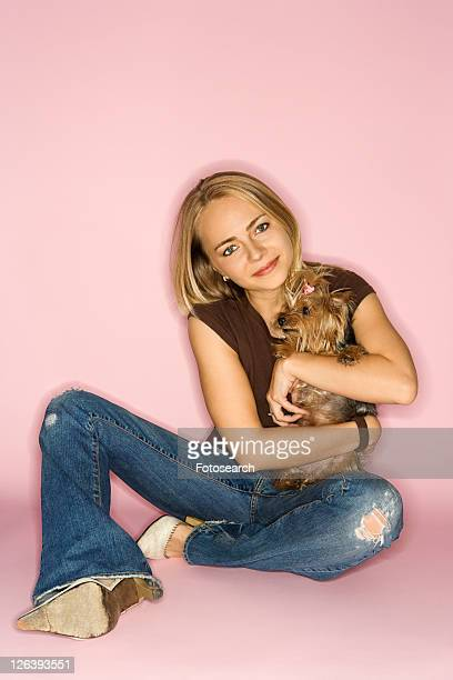 Caucasian young adult female with Yorkshire Terrier dog.