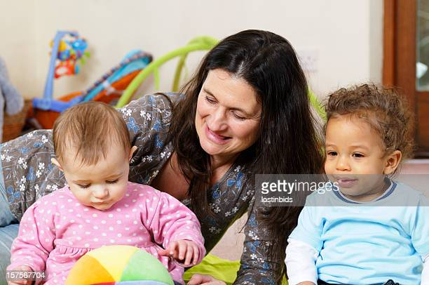 Caucasion Woman Enjoying Playtime With Babies