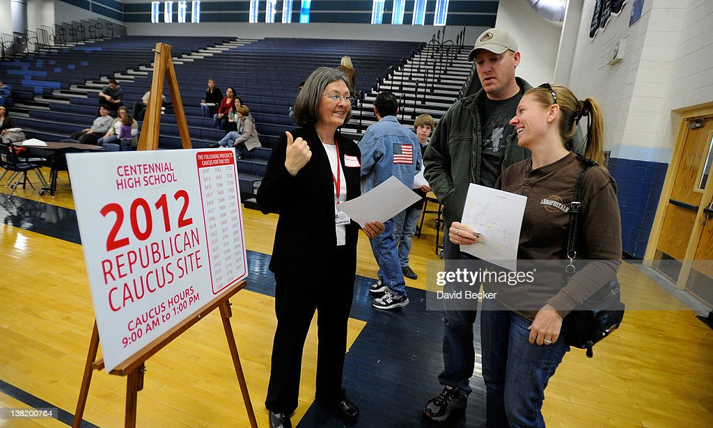 A caucus volunteer (L) directs attendees before the start of the Republican caucus at Centennial High School on February 4, 2012 in Las Vegas, Nevada. Nevada is the first state in the West to vote as Republicans go about choosing their presidential candidate.