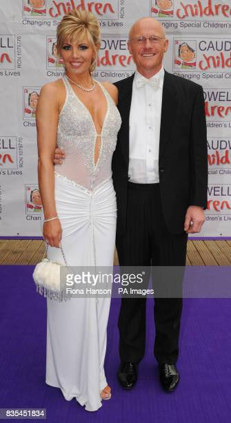 Caudwell Children event sponsor John Caudwell and partner Claire Johnson Caudwell arrive for the Butterfly Ball in Battersea Park London The event by...