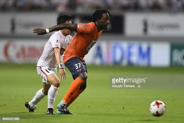 Caue of Omiya Ardija controls the ball under pressure of Yoshiki Takahashi of Sagan Tosu during the JLeague J1 match between Sagan Tosu and Omiya...