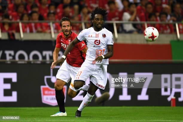Caue of Omiya Ardija controls the ball under pressure of Zlatan Ljubijankic of Urawa Red Diamonds during the JLeague J1 match between Urawa Red...