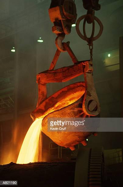 Cauldron pouring molten copper in smelting process