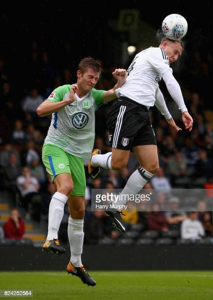 Cauley Woodrow of Fulham and Robin Knoche of VfL Wolfsburg battle for possession during the PreSeason Friendly match between Fulham and VfL Wolfsburg...