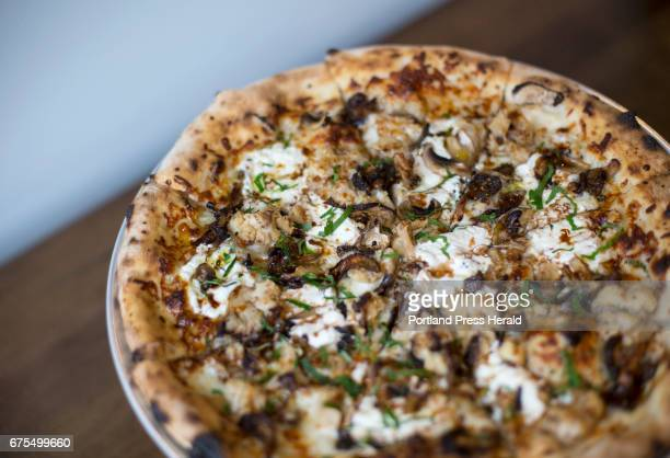 Cauliflower and mushroom pizza with ricotta thyme saba crispy garlic