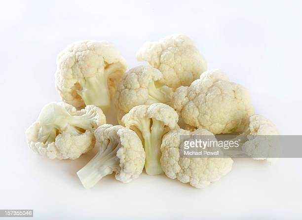 cauliflower florets on white background