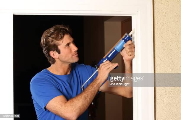 Caulking Gun Man in Blue Shirt