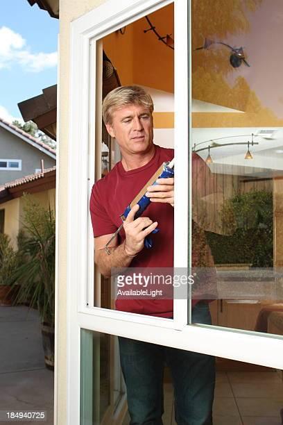 Caulking Man Insulates Window