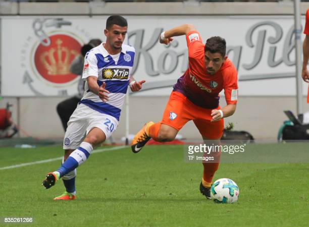 Cauly Oliveira Souza of Duisburg and Danilo Soares of Bochum battle for the ball during the Second Bundesliga match between MSV Duisburg and VfL...