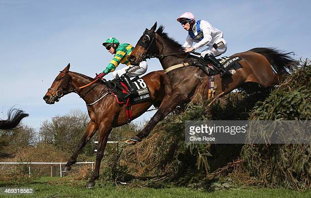 Cause of Causes ridden by Paul Carberry and Knight In Milan ridden by James Reveley in action during the 2015 Crabbie's Grand National at Aintree...