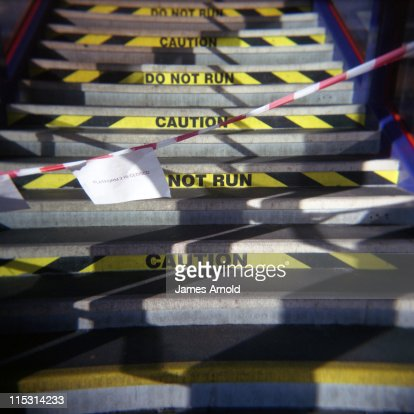 Caution Do Not Run sign on stairs : Stock Photo