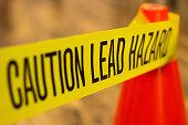Caution tape describing lead-based paint hazard.
