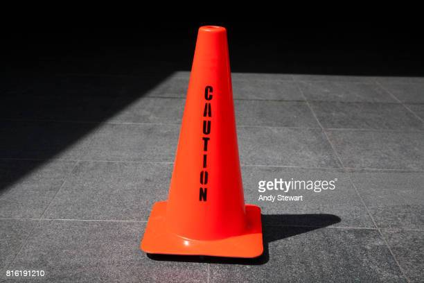 Caution message on red traffic cone