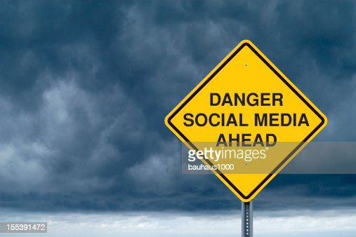 Caution Sign in Front of Storm Clouds