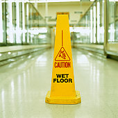 Caution sign in supermarket frozen food aisle, close-up