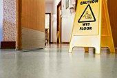 Caution sign on hospital floor