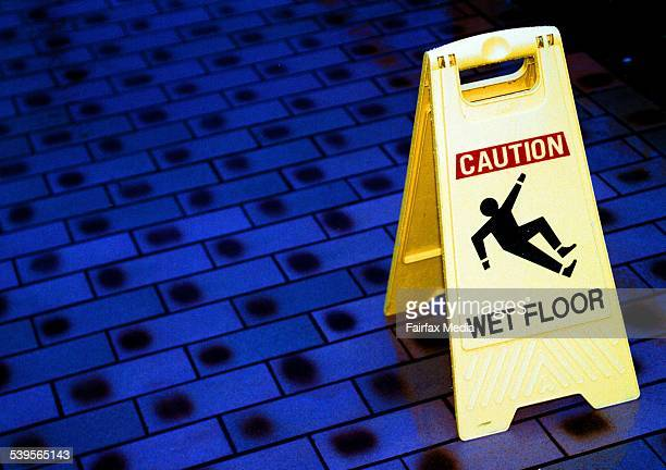 Caution sign warning of a wet floor 15 April 2002 AFR Picture by ROB HOMER