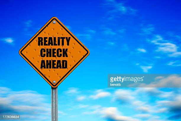 A caution signage saying REALITY CHECK AHEAD