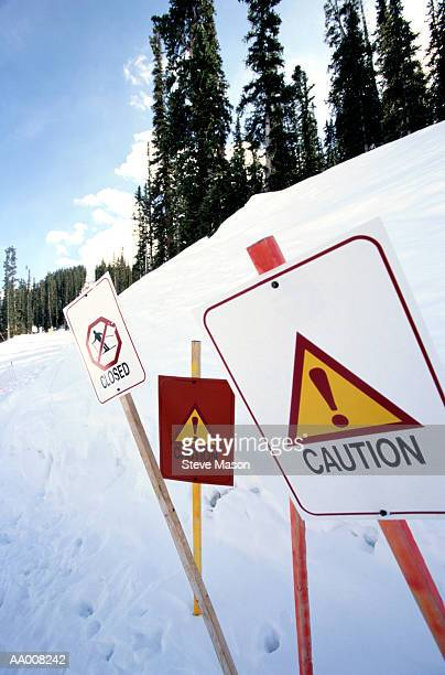 Caution Signs in a Closed Ski Area