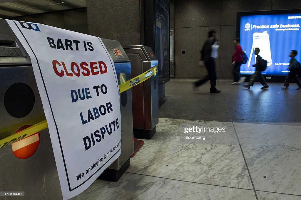 Caution tape and a 'closed' sign are displayed in the Bay Area Rapid Transit (BART) Embarcadero station in San Francisco, California, U.S., on Tuesday, July 2, 2013. Trains linking downtown San Francisco to its airport and the East Bay area are likely to remain idle today, officials said, as a strike entered its second day, forcing about 400,000 riders to commute by car, bus or ferry. Photographer: David Paul Morris/Bloomberg via Getty Images