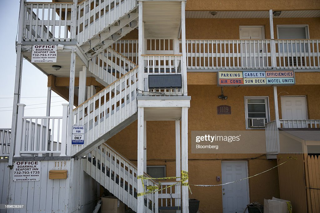 Caution tape is placed alongside an Inn in Seaside Heights, New Jersey, U.S., on Wednesday, May 29, 2013. Sandy, which came ashore near Atlantic City, killed dozens of people and destroyed more than 365,000 homes in the state. Christie has said it will cost $36.9 billion for repairs and to prevent devastation from future storms. Photographer: Scott Eells/Bloomberg via Getty Images