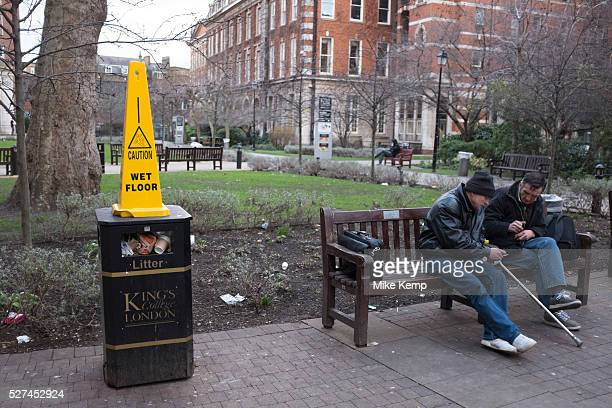 Caution Wet Floor warning cone on a rubbish bin at Guy's Hospital in Southwark London UK