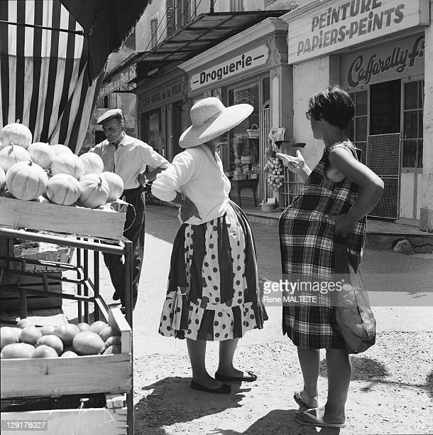 Cavaillon In France In 1970 Two pregnant women talking about a market
