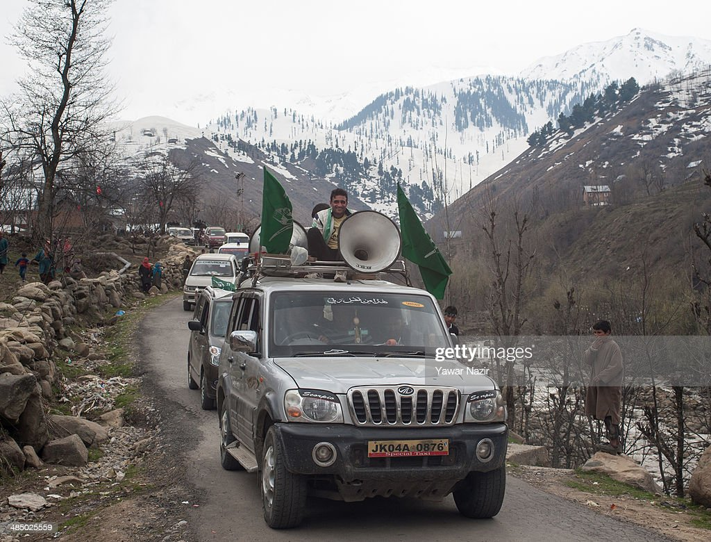 A cavalcade of Kashmir's main opposition political party, Peoples Democratic Party's (PDP) leader Mehbooba Mufti, and candidate for South Kashmir passes on a road during her road show on April 15, 2014, in Tsimer about 90 km south of Srinagar, the summer capital of Indian administered Kashmir, India.Kashmir's main opposition political party, Peoples Democratic Party's (PDP) leader Mehbooba Mufti, and candidate for South Kashmir started off with road shows across 21 villages as a part of her election campaign for the upcoming Lok Sabha polls on Tuesday. She started from Pahloo of the Noorabad constituency.