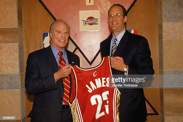 Cavaliers owner Gordon Gund and deputy commissioner Russ Granik pose for a portrait as they hold up the jersey to be worn by first draft pick LeBron...