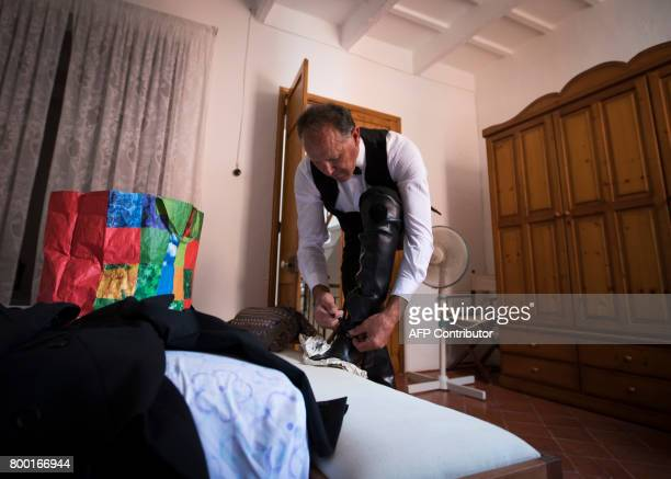 'Cavaller' Toni Galmes laces his boots before the traditional San Juan festival in the town of Ciutadella on the Balearic Island of Menorca on the...