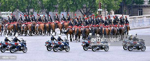 Cavalry of the Republican guard march during annual Bastille Day military parade in the Republic Day on the Champs Elysees in Paris France on July 14...