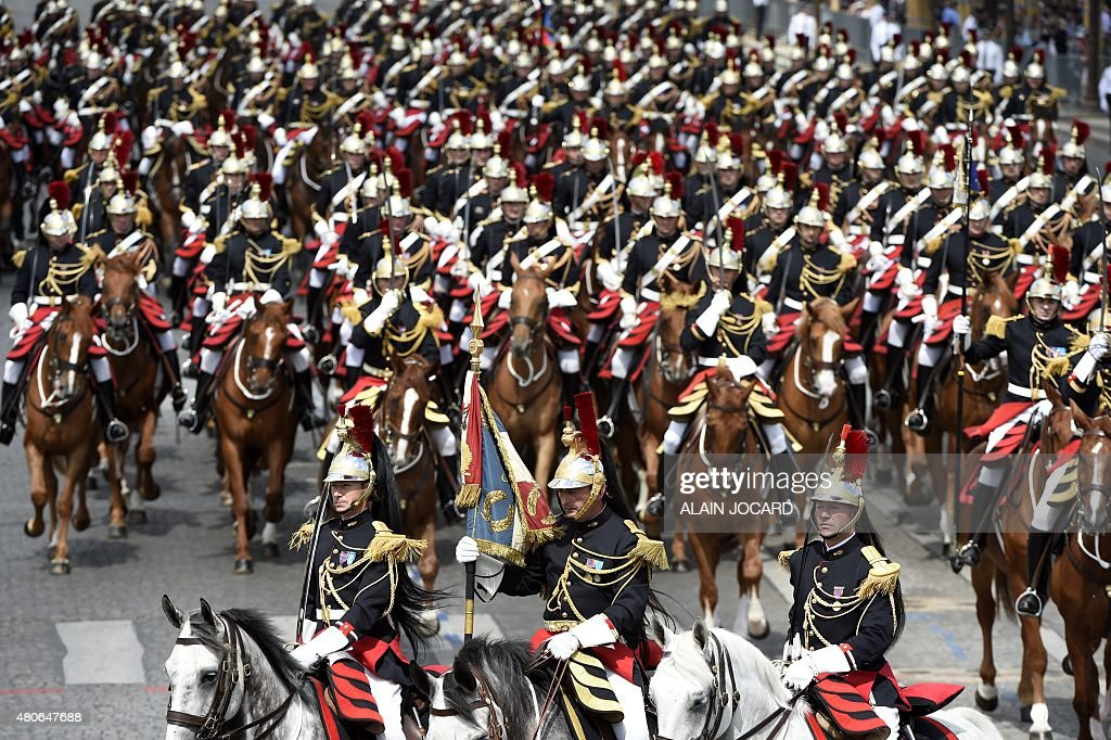 Cavalry of the Republican guard take part in the annual Bastille Day military parade in Paris on July 14 2015 AFP PHOTO / ALAIN JOCARD