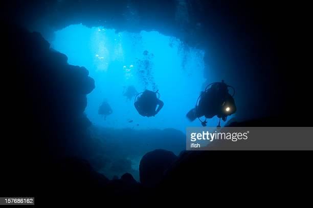 Cave Divers diving into the Santa Maria Caves, Comino, Malta
