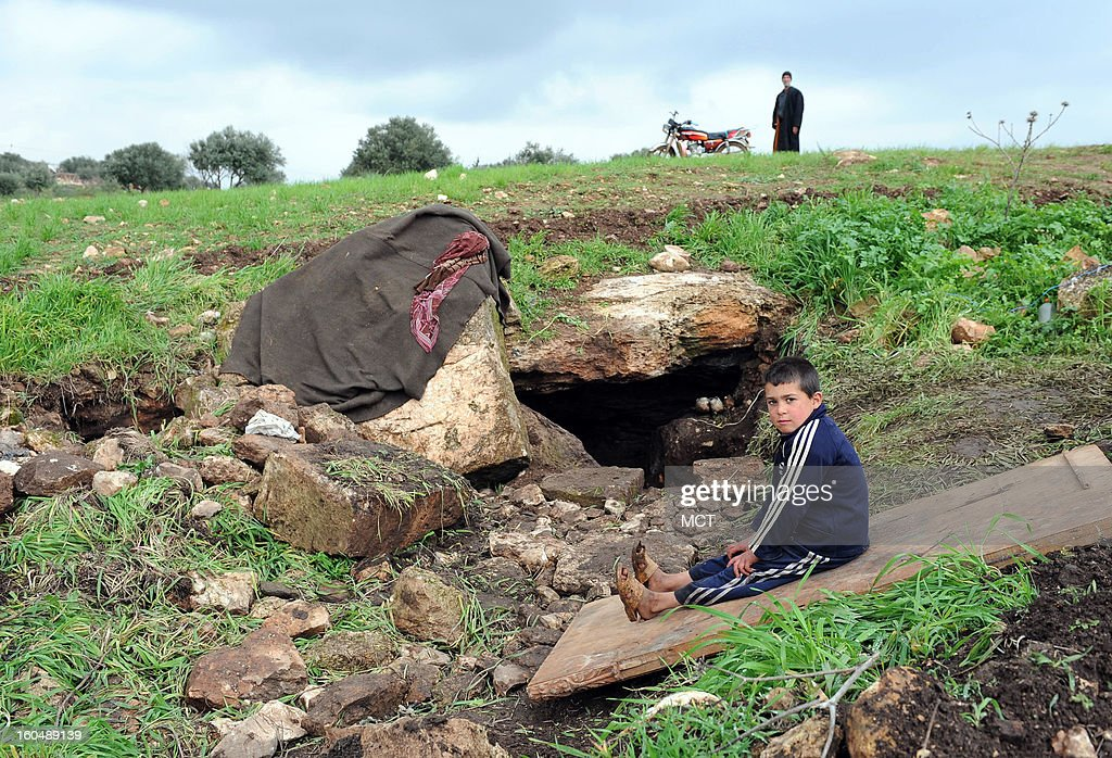 A cave outside the village of al Sahriah, north of Hama, is where this family of 16 is now living. They fled from nearby Kifrimboudah, which is now under air and artillery attack in a government offensive to recapture lost territory.