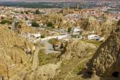Cavehouses at Santiago troglodyte quarter and the Alcazaba at background Guadix Marquesado region Granada province andalusia Spain