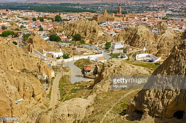 Cavehouses at Santiago troglodyte quarter and the Alcazaba at background Guadix Marquesado region Granada province andalusia Spain