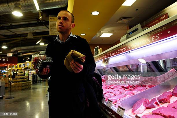 Caveman' Vlad Averbukh a follower of 'The Paleo Diet' eats shops for grassfed raw meat and berries in New York February 04 2010 Vlad an adept of...