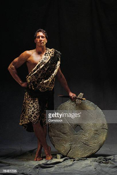 Caveman with carved wheel